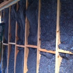 The stud wall with denim insulation