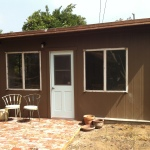 Studio with hardy board siding and reclaimed brick patio